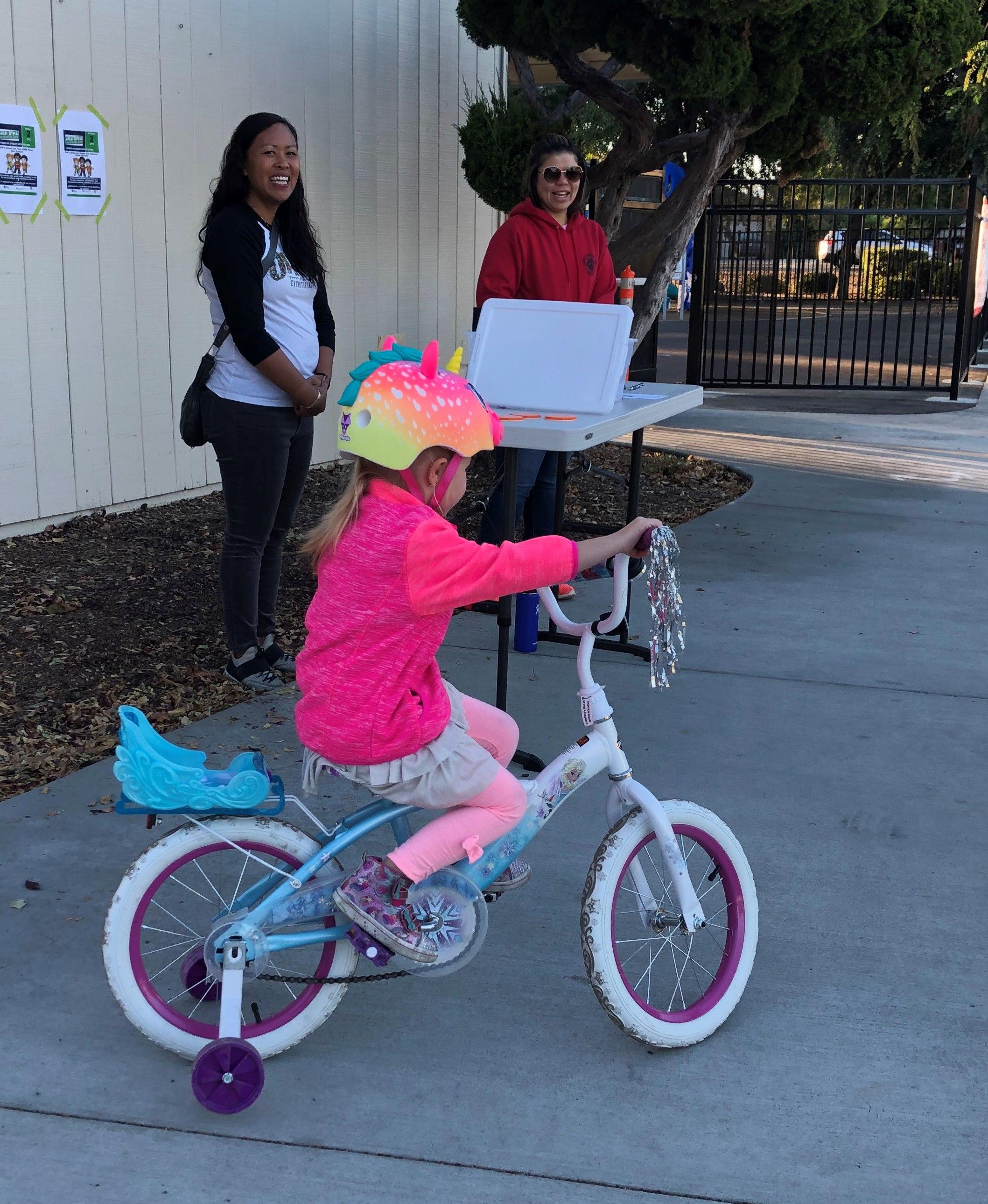 Student on bike wearing helmet