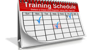 Spiral bound monthly calendar with words Training Schedule in red background header.