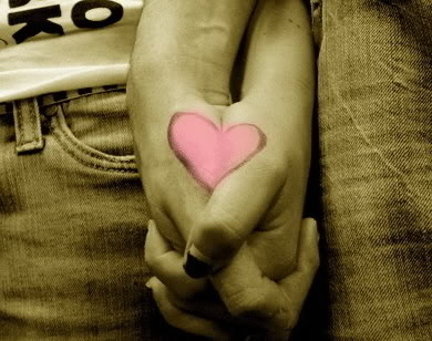 Holding hands with a pink heart drawn across both hands.