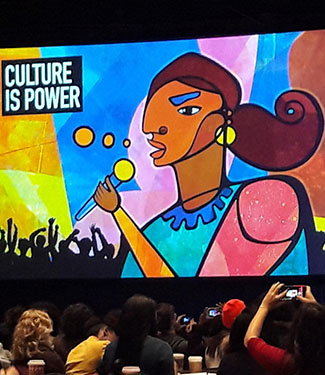 Culture is Power. An impressionist style painting of  women of color holding a microphone.