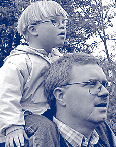 young child rides on the shoulders of a young man