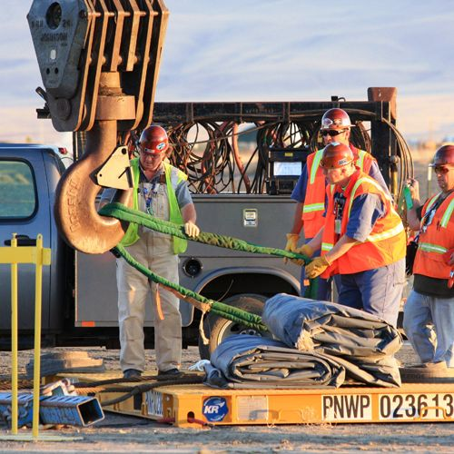 Workers with crane on the Hanford site.