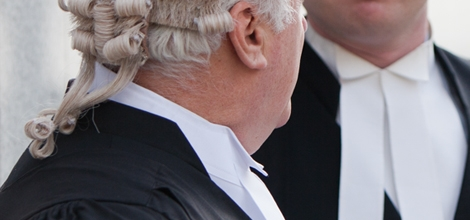 lawyers in silks and wigs