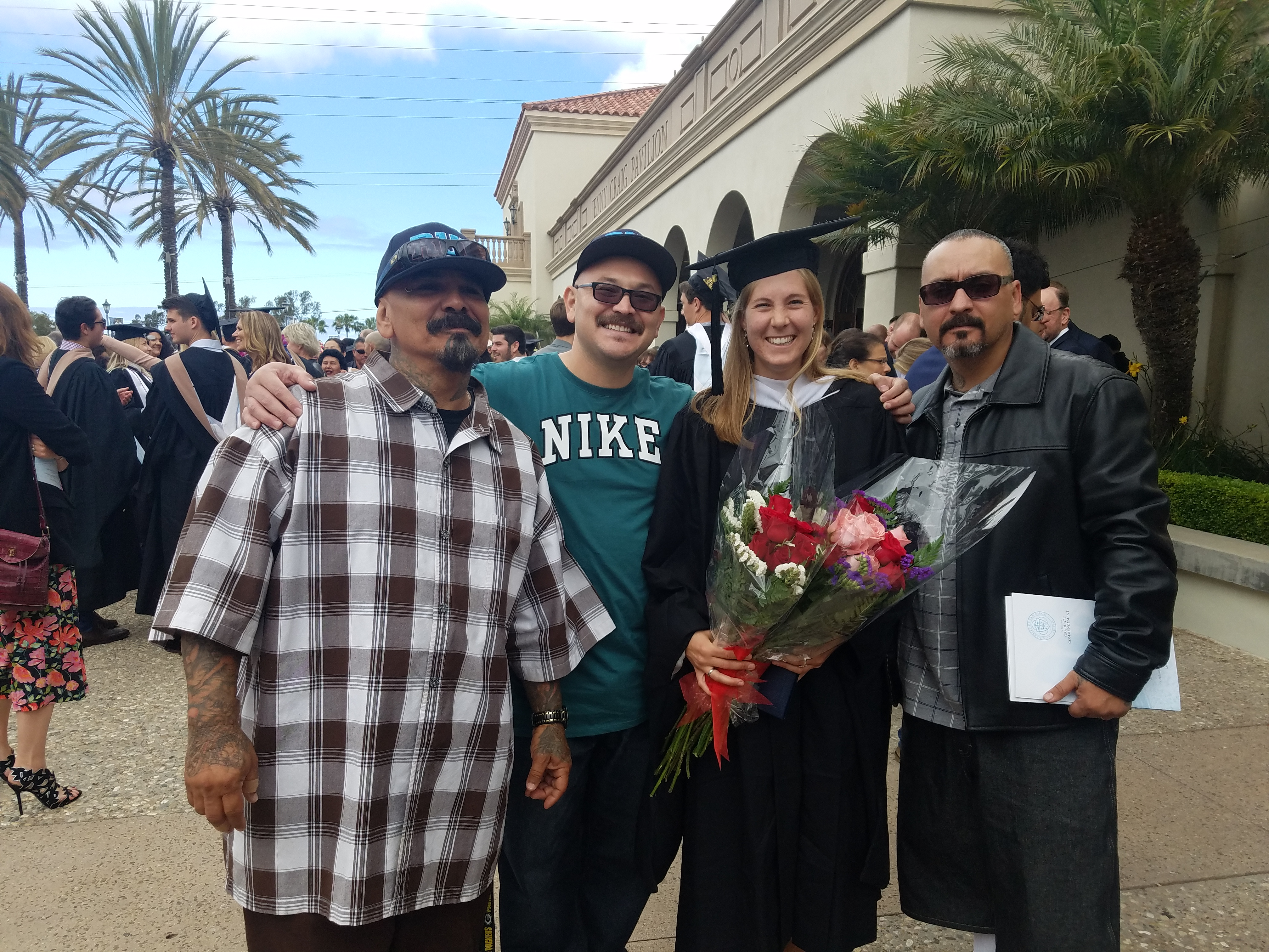 Leslie with three Rise Up Industries members at her Kroc School graduation in May 2018.