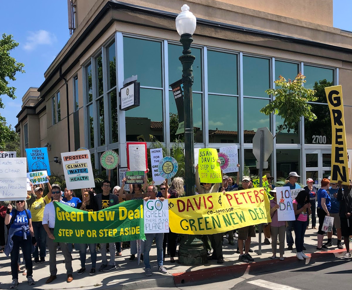 Green New Deal protest outside of rep. susan davis's office