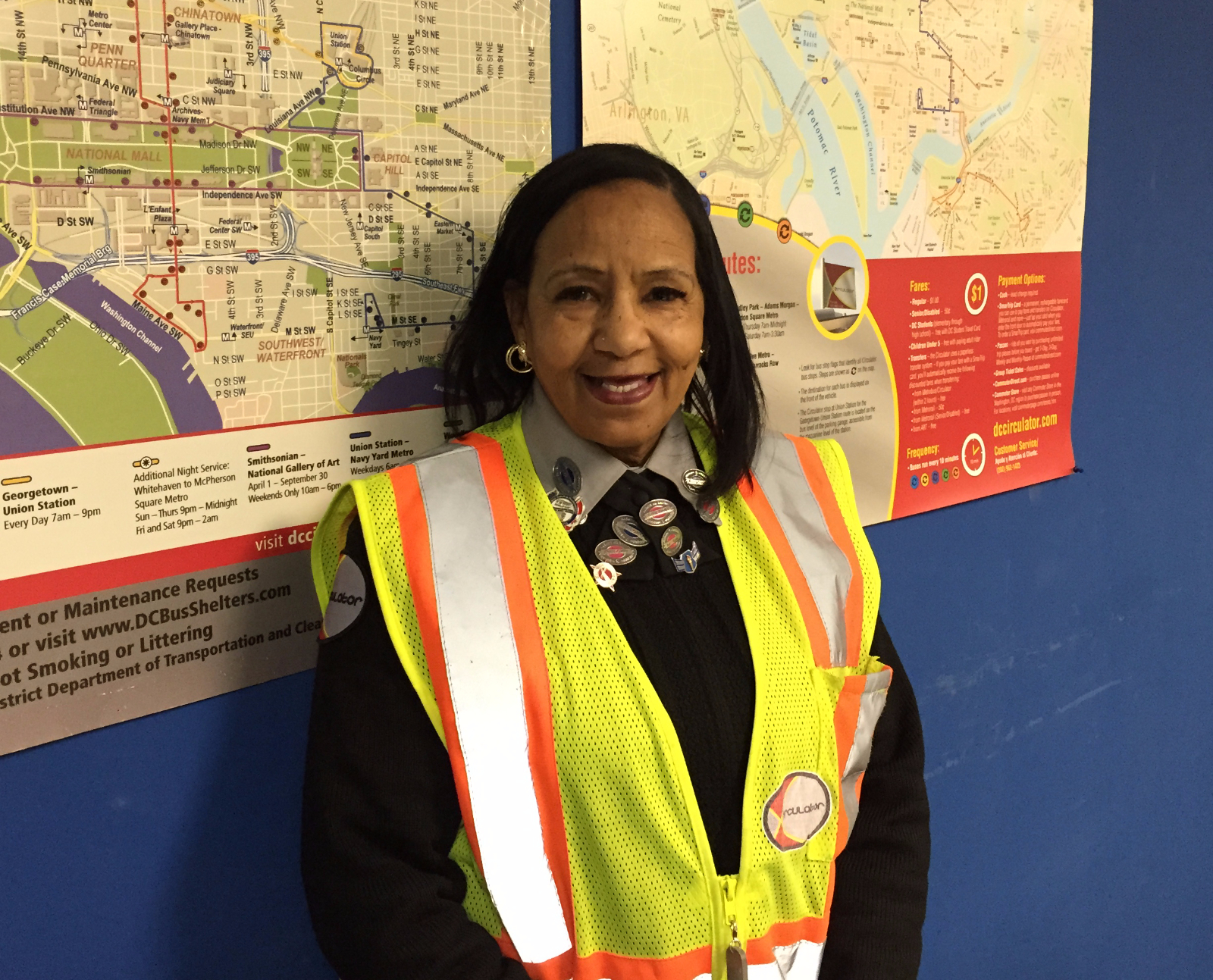 Operator Mabry poses in front of vintage Circulator route maps.