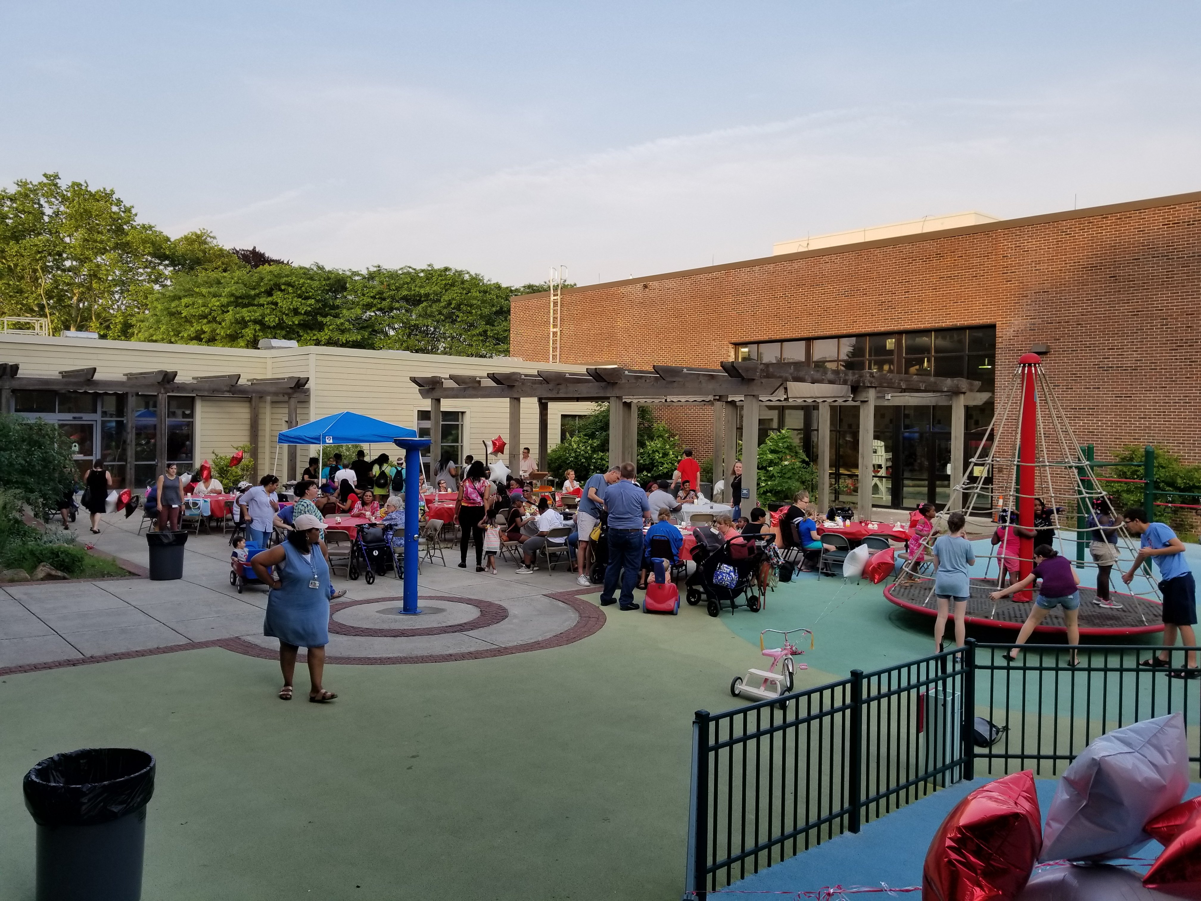Students and families enjoy a BBQ at Funky Friday Family BBQ and Swim, May 2018.