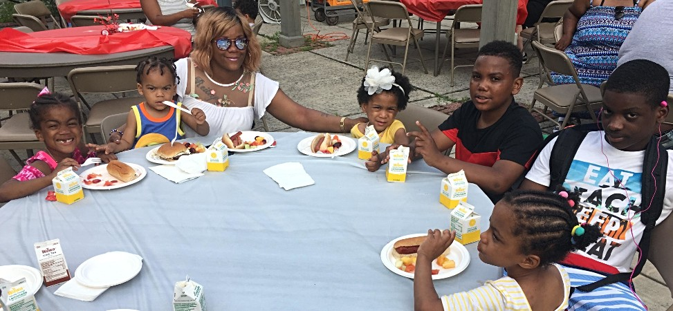"""Our """"Family Spotlight"""" family for September 2018! Early Childhood student Coco with her 5 sibling and their Mom at Funky Friday Family Swim and BBQ in May 2018."""