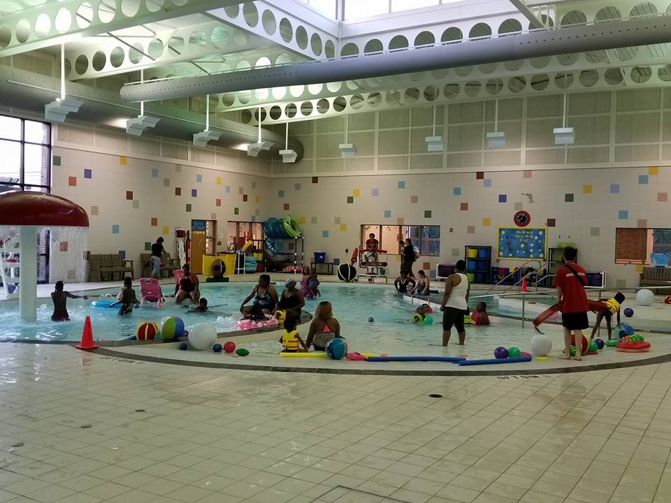 Students and families enjoy swimming at Funky Friday Family BBQ and Swim, May 2018.