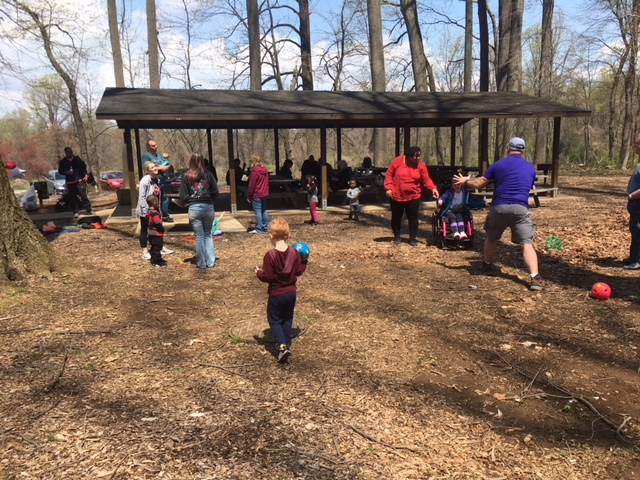 Participants of a walk and roll in the woods at Ridley Creek State Park gather under and around a picnic pavilion on a beautiful spring day!