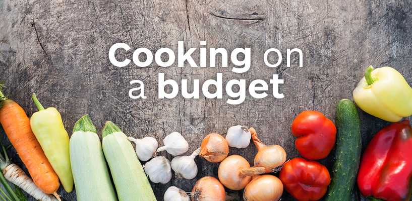 the words cooking on a budget are displayed over a background of a wooden table with vegetables nearby
