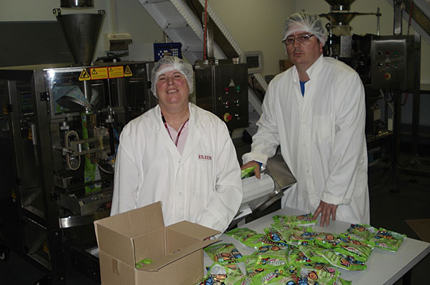 From left: Ollie's Lollies supported employees Eileen Spencer and Paul Houlihan packaging bags of lollies for resale.