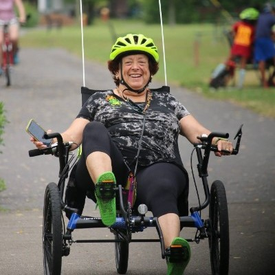 Person enjoying a recumbent tricycle at the GIAC Seniors event. Photo: Edna Brown
