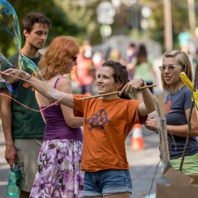 Ithaca Children's Garden playworkers making gigantic bubbles