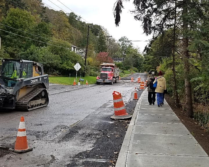 New sidewalk on Spencer Rd gives people a safe place to walk.