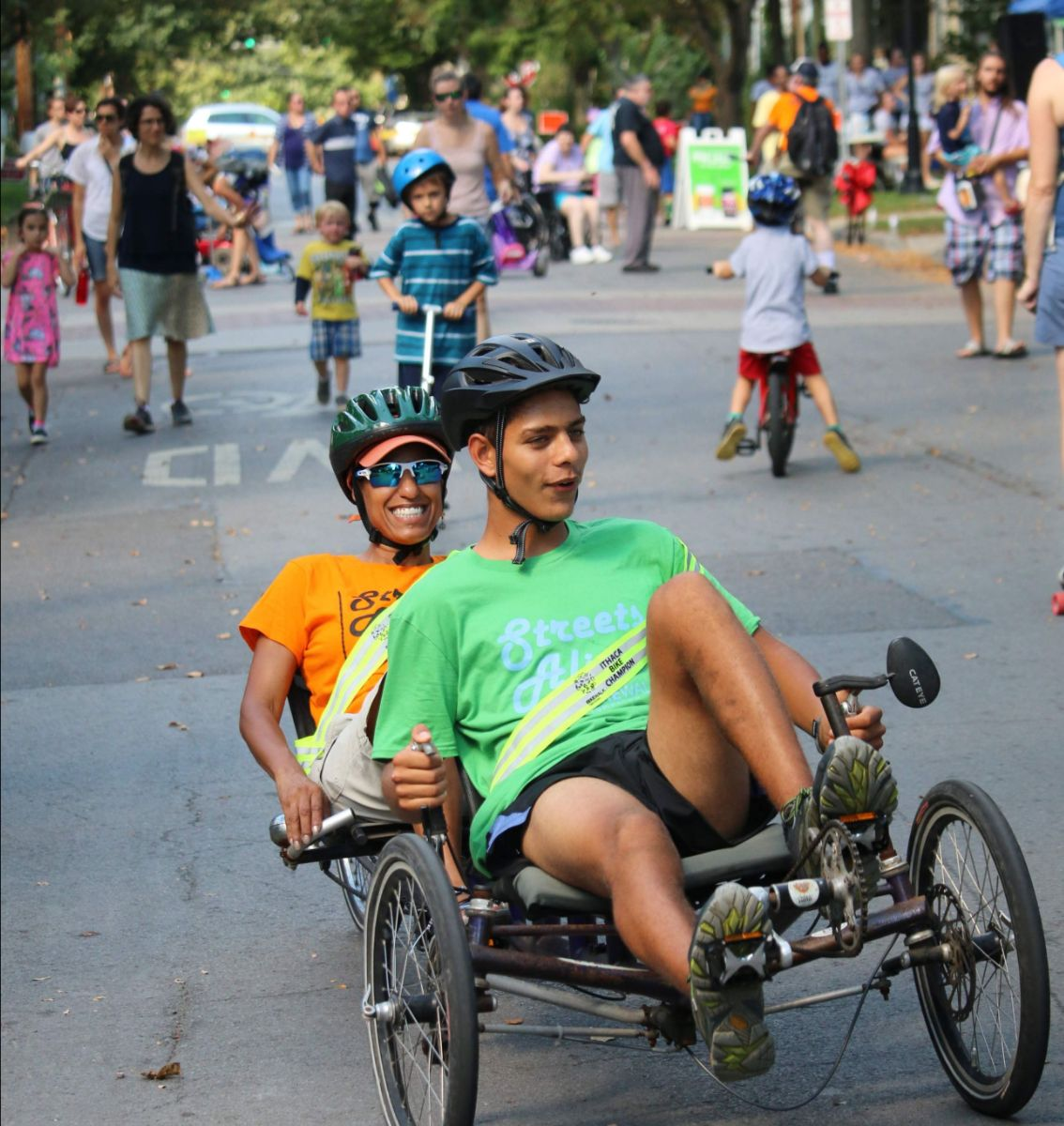 Ithaca Bike Champions demonstrate a recumbent tandem tricycle at Streets Alive last year.