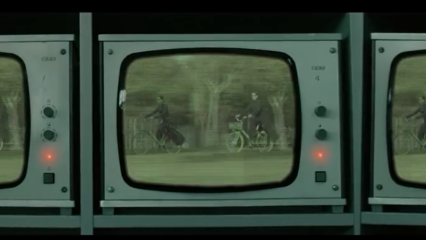 Neo and Trinity seen biking in a closed-circuit TV
