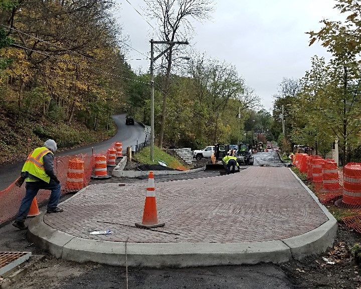Mountable curb on Spencer Rd provides traffic calming for neighbors while allowing access for emergency vehicles.