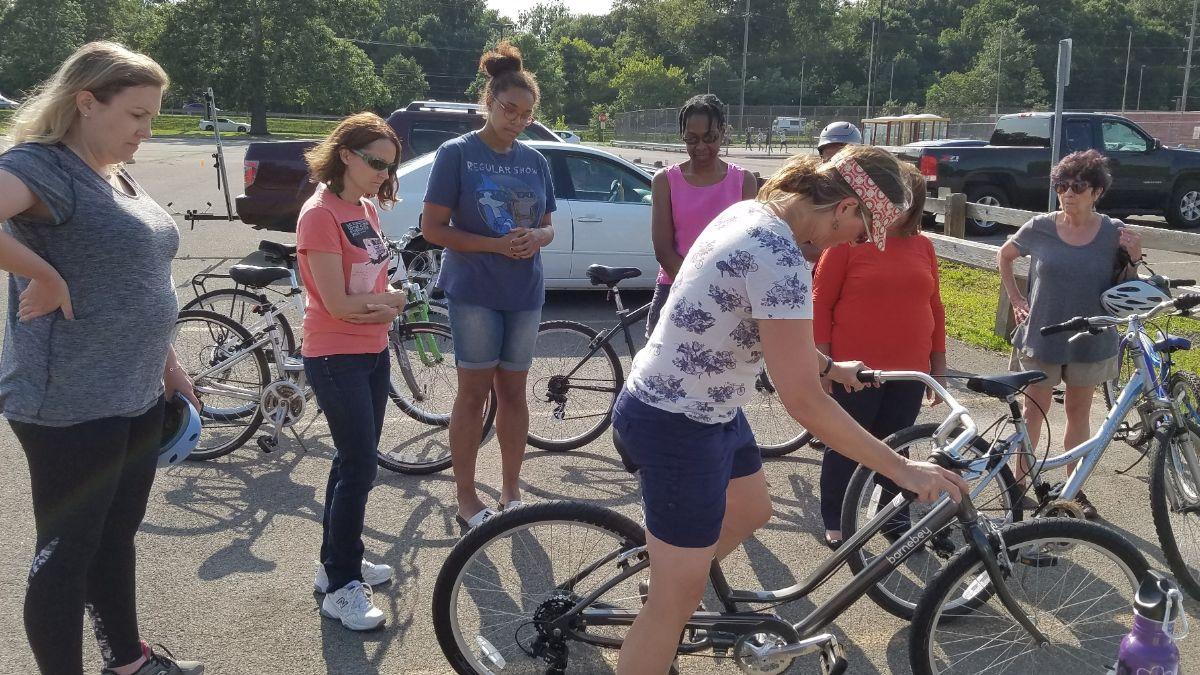 Instructor Molly Hajjar shows bike skills to a crowd.