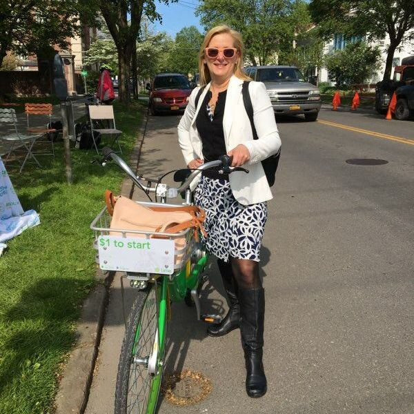 "Laurie ""looking stylin'"" on her way to work with a Lime-E bike"