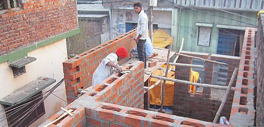 Image of construction of new homes in India