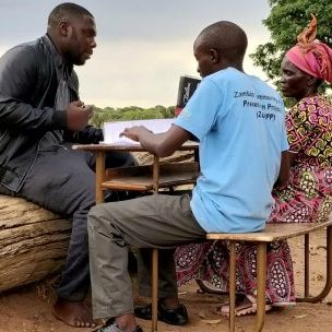 Photo: A GAPA facilitator and notetaker conduct a key informant interview in Zambia (Credit: Francesca Booker/IIED)
