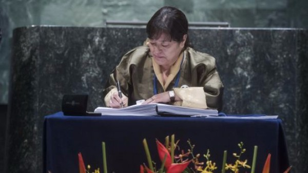 Picture of the Permanent Representative of the Kingdom of Bhutan to the UN signing the Paris Agreement