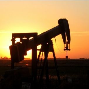 An oil rig silhouetted at sunset in the Oklahoma Panhandle (Photo: Gina Dittmer, Creative Commons)