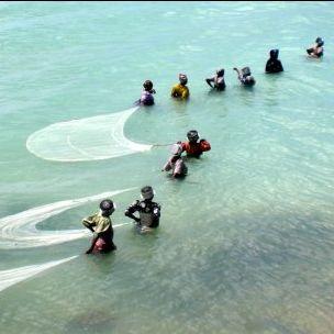 Tanzanian women fishing in shallow water (Matt Kieffer, Creative Commons via Flickr)