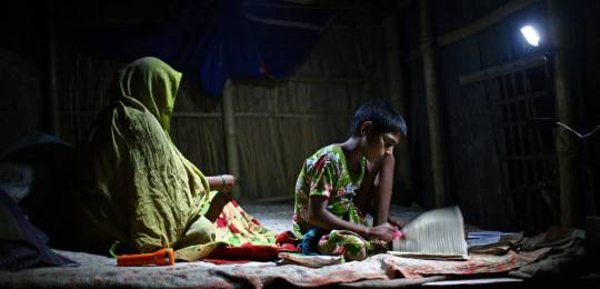 In the absence of electricity, students in Bangladesh are given charger lights so they can study at home