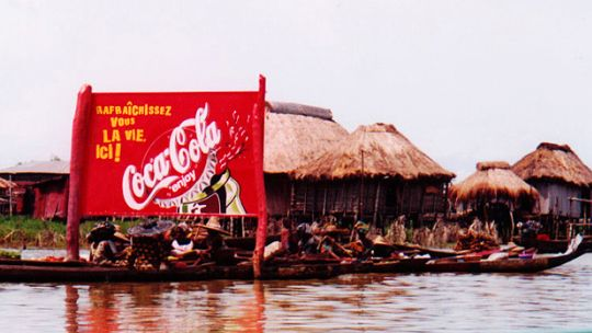 A Coca-Cola sign outside a small town in Benin. (Photo: Lorena Pajares, Creative Commons via Flickr)