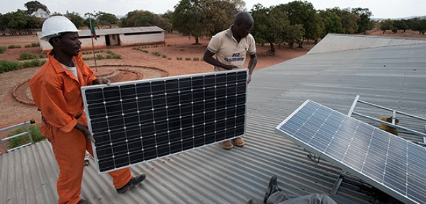 A macrosolar installation is carried out on a school in Zambia. Sustainable energy solutions for Least Developed Countries were discussed at the event in London (Photo: Steve Woodward)