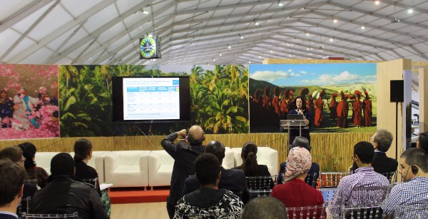 Photo of IIED's Krystyna Swiderska discussing the latest research on how indigenous people adapt to climate change at a side event at the 2016 UN climate conference in Marrakech.