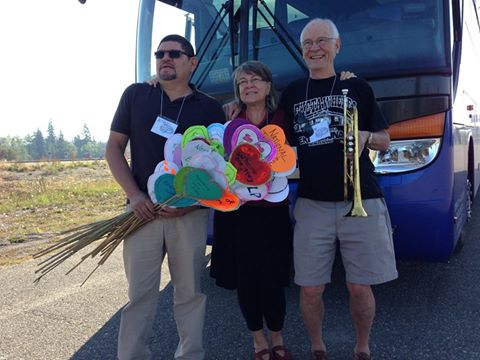 Participants of the Rolling Justice Bus with hearts