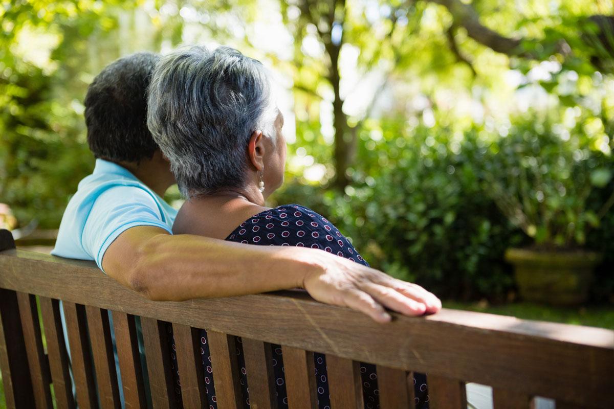senior citizens sitting on park bench