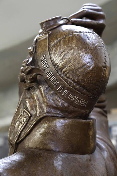 Amy Johnson statue helmet reads 'Believe bothing to be impossible'