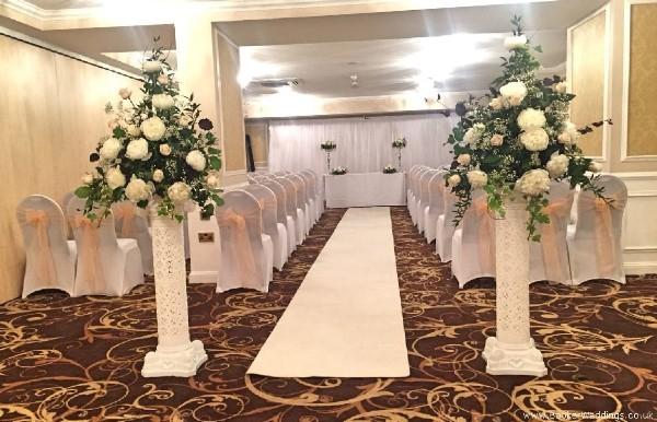 Wedding Venue Pedestal Arrangements in Peaches and Cream