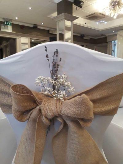 Hallmark Hotel Wedding Flowers on chairs