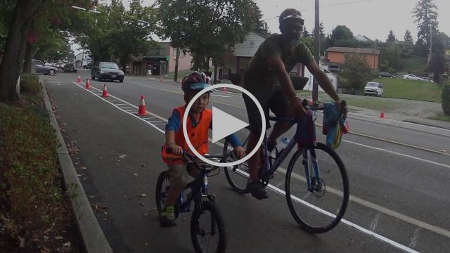 Four-year-old biking on Rainier Ave: PARK(ing) Day 2015