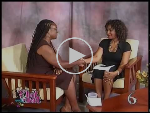 Roslyn Douglas founder of Central Health - Grenada talking to Lexan Fletcher