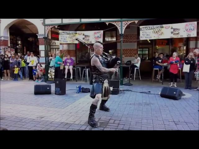 Impressive Scottsman Playing ACDC on flaming bagpipes