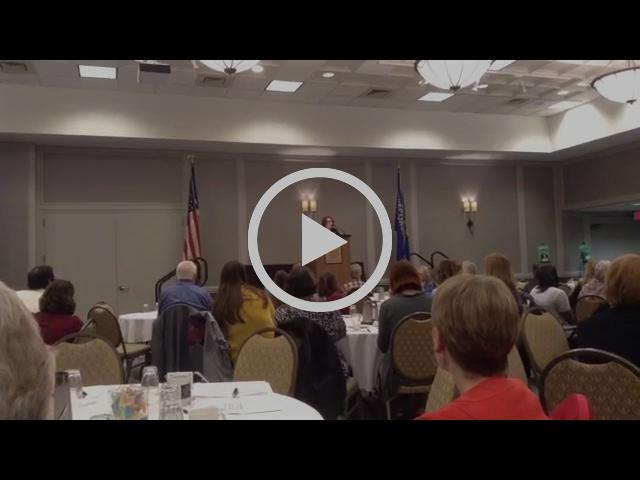 Bridges director Connie Meyer speaking to librarians