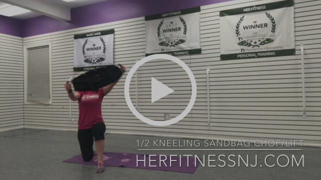 Half Kneeling Sandbag Chop Lift