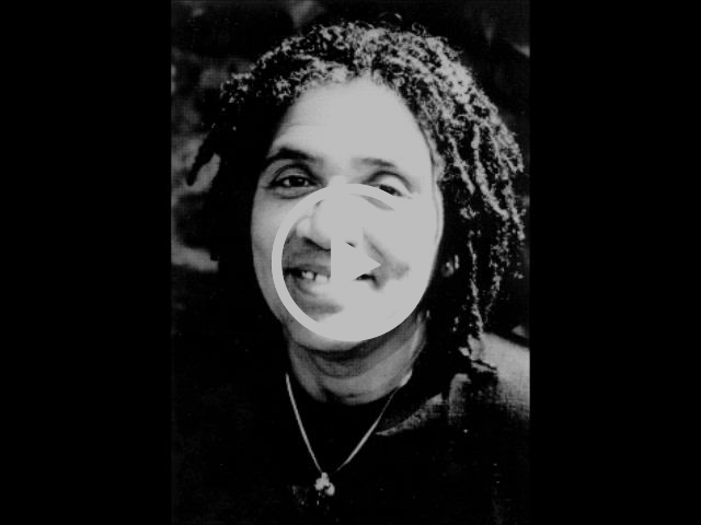Audre Lorde. Smiling Black woman.