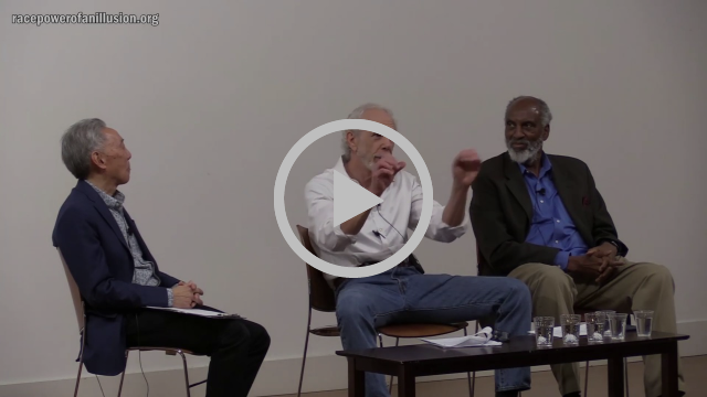 Image grab from a video of a gathering to celebrate the launch of the new race site showing michael omi, larry adelman and john powell seated on a stage.