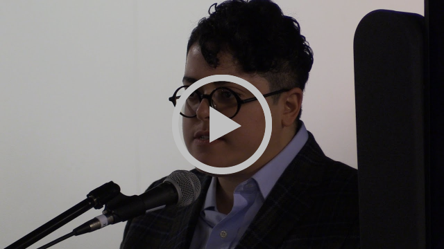 Aimi Hamrai gives a talk inside a lecture space in this image grab from the video