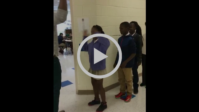 Teacher Shows off Epic Handshakes with Students
