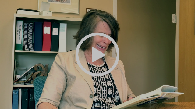 Screenshot of director Connie Meyer reading a book